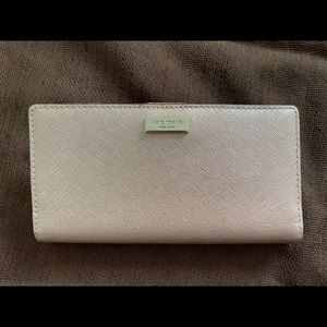 Kate Spade wallet in dull pink color